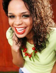 Happy Young Woman Considers Invisalign vs Smile Direct in Hillsboro OR