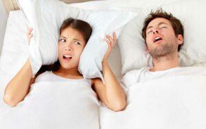 Man Snoring at Night Needs MARPE Snoring Solution from Hillsboro Dental Excellence