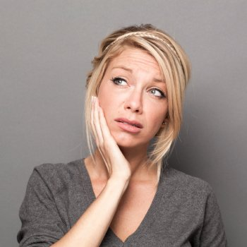 Woman with TMJ Pain Seeks TMJ Treatment from Hillsboro Dental Excellence