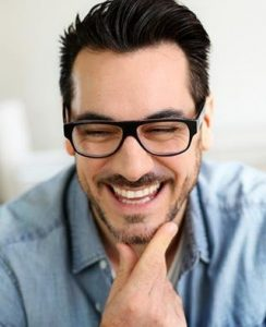 Happy Man Considers Invisalign Cost with Hillsboro Dental Excellence
