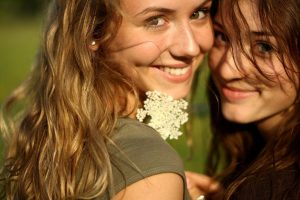 Young Women Smile About Cosmetic Dentistry Procedures from Hillsboro Dental Excellence