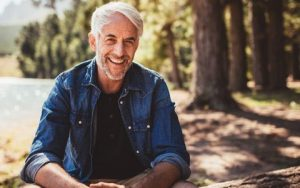Man Outside Smiling with Porcelain Veneers from Hillsboro Dental Excellence