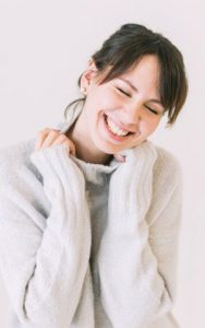 Happy Woman Learns What Dental Veneers Are from Hillsboro Dental Excellence