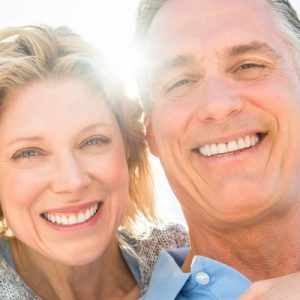 Happy Couple Considers Cost of Dental Implants from Hillsboro Dental Excellence