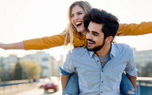 Laughing Couple Happy About Free Dental Implant Consultation with Hillsboro Dental Excellence