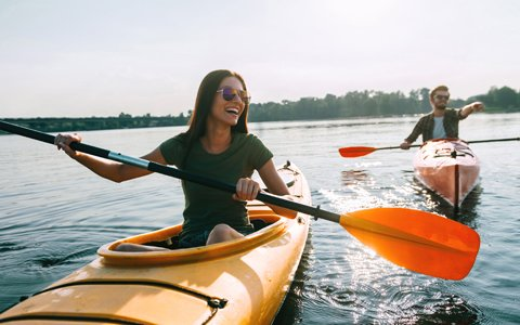 Woman Kayaking with Full Mouth Reconstruction from Hillsboro Dental Excellence